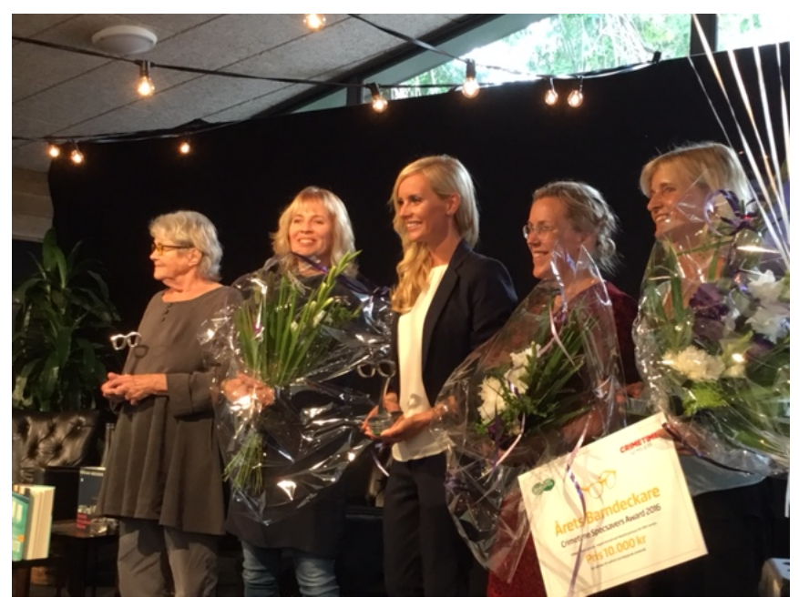 Mariette, second from left, receiving the award
